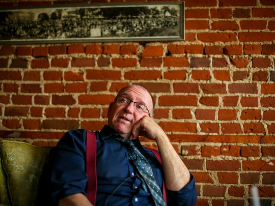 """Bob Leonard 64, of Knoxville, has been labeled the ÒTrumpland translator,"""" shown here Thursday, April 12, 2018, in Pleasantville, Iowa, at Smokey Row Coffee."""