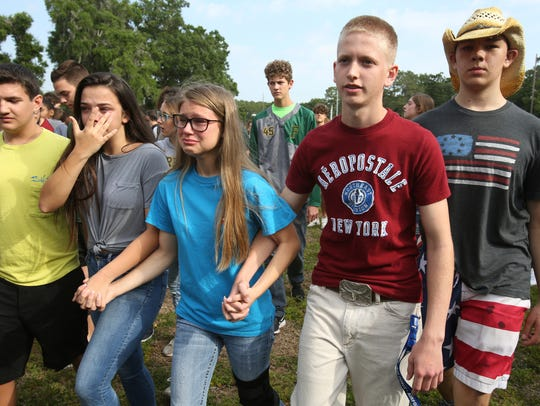 Students are led out of Forest High School after a