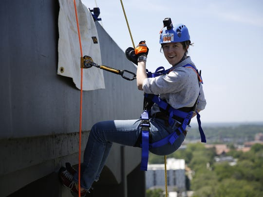 CD Davidson-Hiers rappels down the DoubleTree hotel