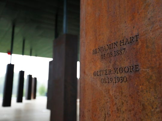 This photo shows names of lynching victims at the National Memorial for Peace and Justice, a new memorial to honor thousands of people killed in racist lynchings, Sunday, April 22, 2018, in Montgomery, Ala. The national memorial aims to teach about America's past in hope of promoting understanding and healing. It's scheduled to open on Thursday. (AP Photo/Brynn Anderson)