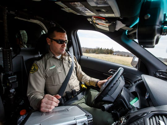 Guthrie County Sheriff's deputy Kent Gries patrols the county Thursday, April 12, 2018. He was one of three deputies injured in a Stuart shooting Oct. 17, 2019.