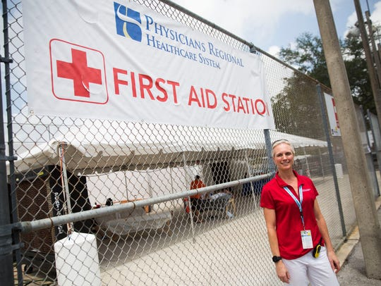 Dr. Christina Kabbash stands outside the first-aid