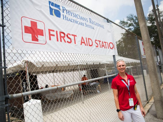"""Dr. Christina Kabbash stands outside the first-aid station Tuesday, April 23, 2018, at the Minto U.S. Open Pickleball Championships in East Naples. """"We're here for the athletes,"""" said Kabbash."""