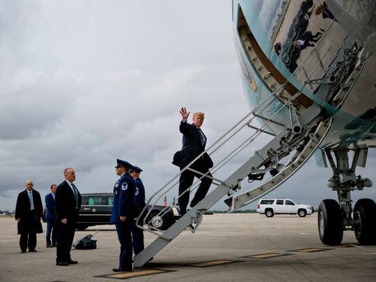 President Donald Trump waves while boarding Air Force One during his departure from Palm Beach International Airport in West Palm Beach, Fla., Sunday, April 22, 2018. (AP Photo/Pablo Martinez Monsivais)