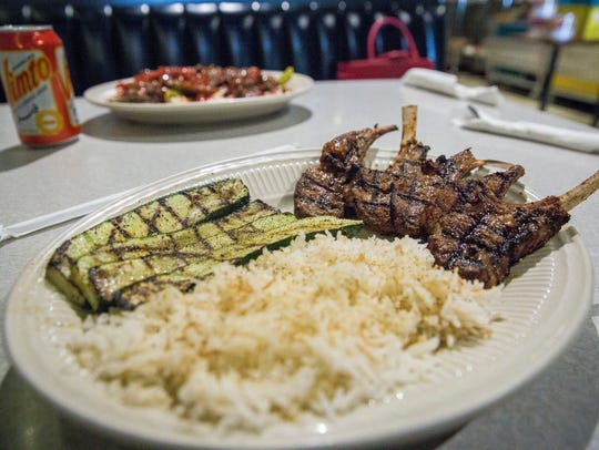 Grilled lamb, zucchini and rice are one of several