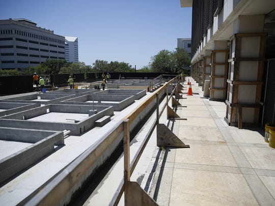Repairs continue on the Senate parking garage at the Capitol Complex Wednesday.