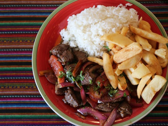 Lomo saltado -- beef tenderloin, onions and tomatoes stir-fried with soy sauce and the South American chile aji Amarillo -- from Culantro, a Peruvian restaurant in Ferndale.