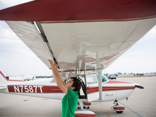 Sailor Robinson checks the wing flaps on his 1960 Cessna 172 before his flying lesson on Tuesday, May 1, 2018, at Naples Municipal Airport.
