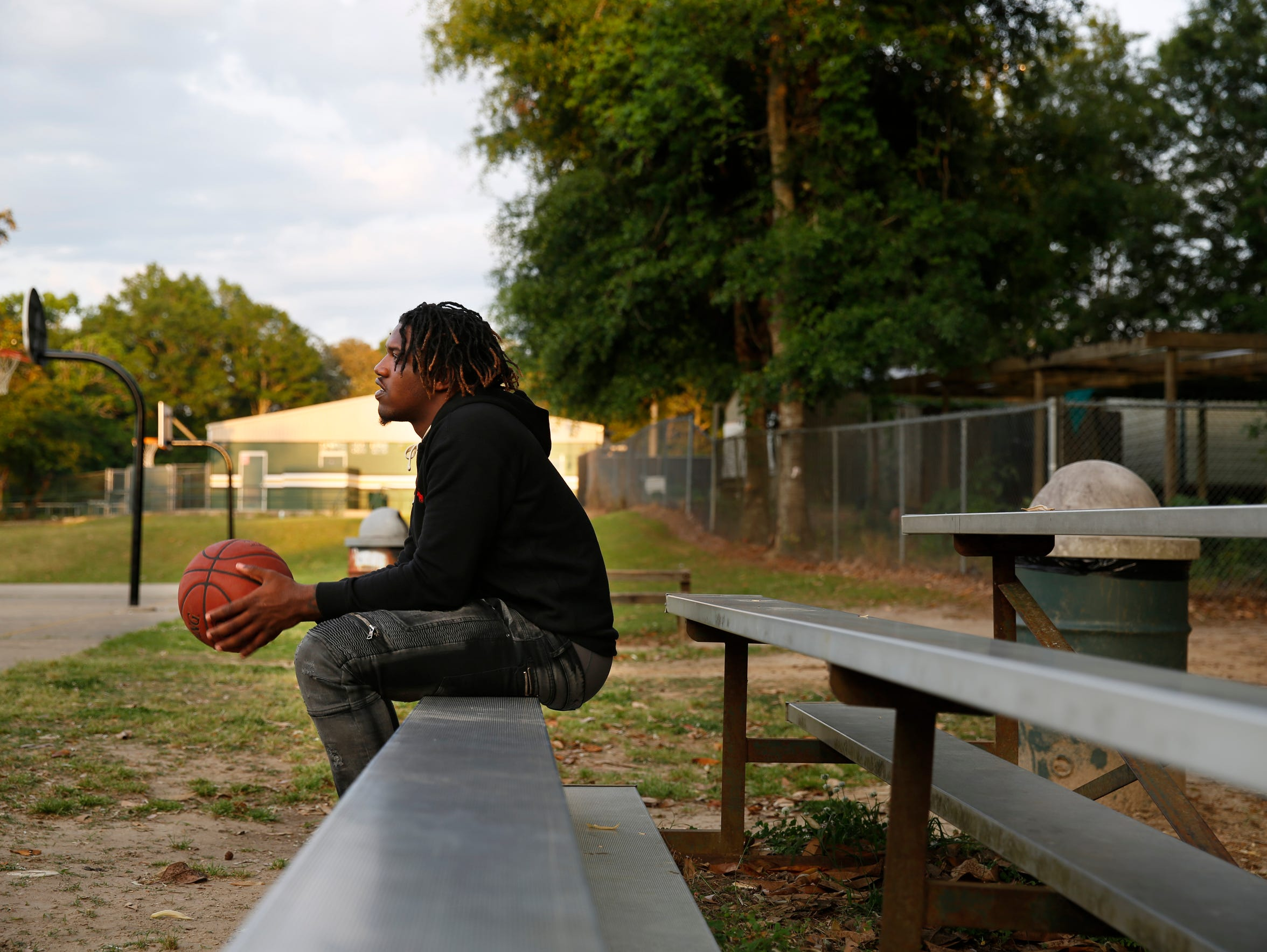 Tyler Farmer looks out over the outdoor basketball