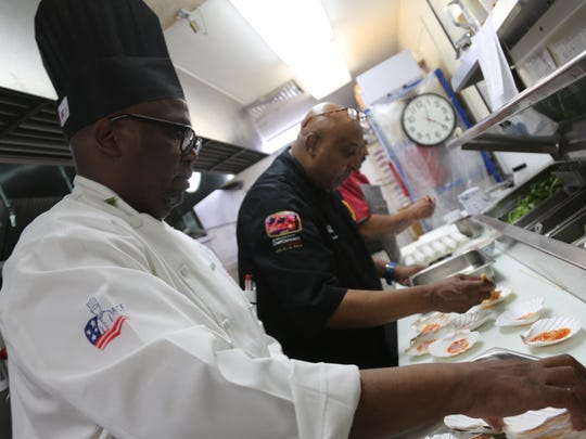 Sous chef Ernest Davis, left, is serving a life sentence at the Lakeland Correctional Facility in Coldwater, Mich., where Executive Chef Jimmy Hill, right, has run a culinary training program for prisoners for nearly 30 years.