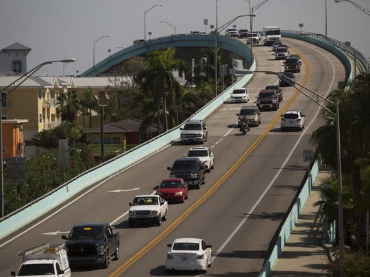 File photo of a line of traffic snakes across the Matanzas Pass Bridge, into Fort Myers Beach.