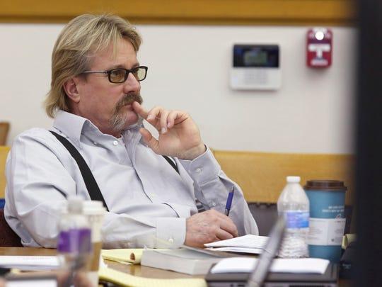 Michael Syperda listens as a witness testifies during