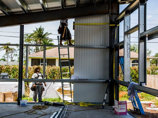 An affordable East Naples home designed to withstand a Category 5 hurricane is under construction on Thursday, May 10, 2018.