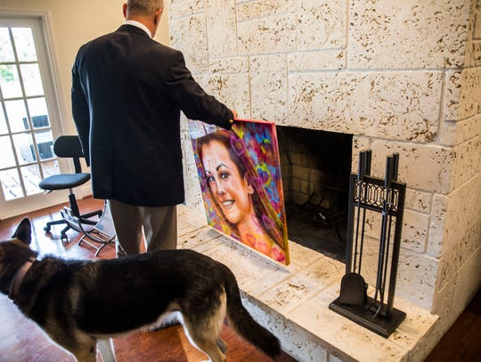 Andrew Pollack brings out a portrait of his daughter