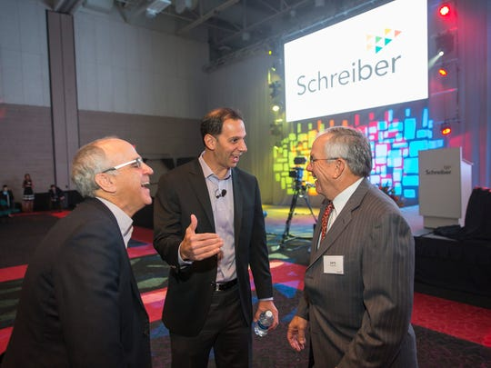 Schreiber Foods CEO Mike Haddad, center, talks with Rick Katz, left, and Larry Ferguson, right at Schreiber's Presidents Award for Excellence presentation.