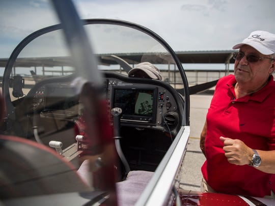 Bob Zaleski explains some of the electronics and navigation in the Sling 2 airplane at Naples Municipal Airport on Thursday, May 10, 2018.