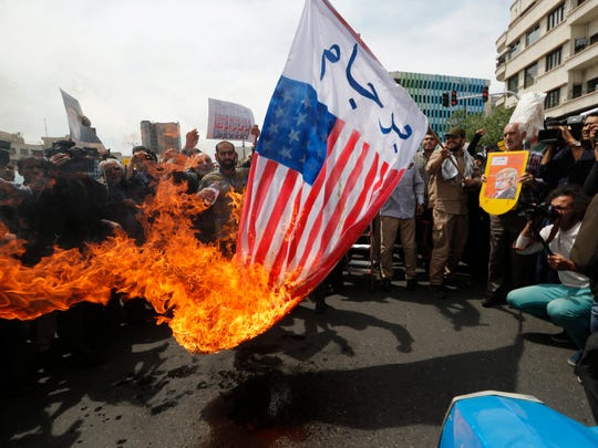 Iranians burn U.S. flags during an anti-American protest