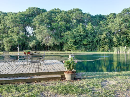 The property includes a fully stocked fish pond.
