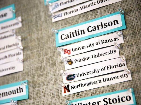 Caitlin Carlson was accepted into four universities, which are displayed on a bulletin board at Marco Island Academy, on Wednesday, May 16, 2018, at the school in Marco Island.