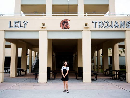 Pilar Forrest, a senior at Lely High School, stands