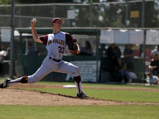 Simi Valley ace Owen Sharts fires a pitch during Thursday's playoff game against St. Bonaventure.