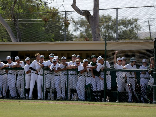 The St. Bonaventure dugout celebrates a hit during Thursday's Division 2 first-round game against visiting Simi Valley.