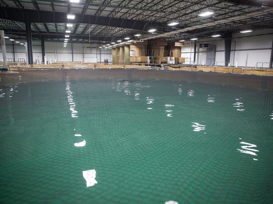 Large 68,684-gallon indoor tanks will house the salmon