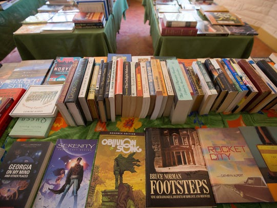 Denise Chavez, author and owner of Casa Camino Real Bookstore, opened a pop-up book and art sale in what was Patina Home,