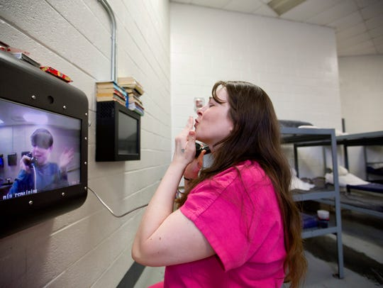 Inmate Krystle Sweat blows a kiss to her son Robby,