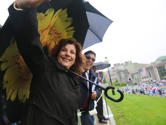 Karen Gonzalez waves as her daughter, Kelsey Sieferth,