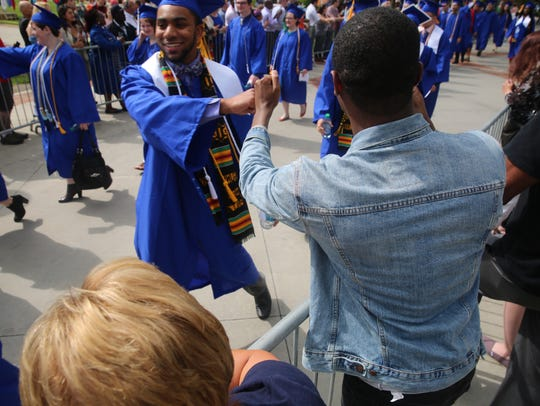 Terrance Morgan (right) greets graduating student Malik
