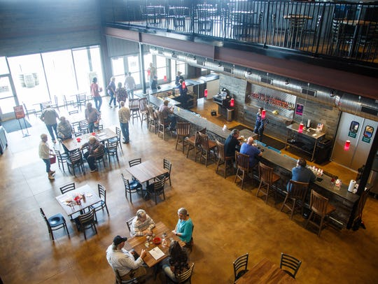 Patrons in the expansive taproom at Toppling Goliath's