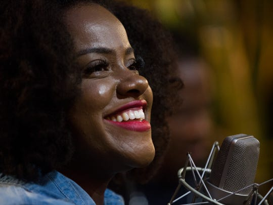 Reggae soul singer and songwriter Etana smiles during