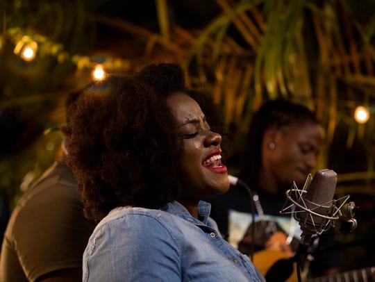 Reggae soul singer and songwriter Etana sings during