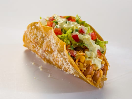 The spicy veggie masala taco is among the new items