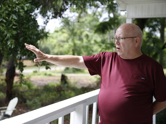 Larry Creamer, a Tallahassee native, stands near his residence.