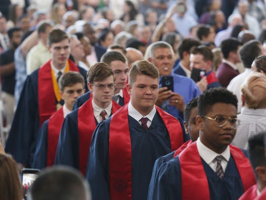 Archbishop Stepinac class of 2018 files into the gym