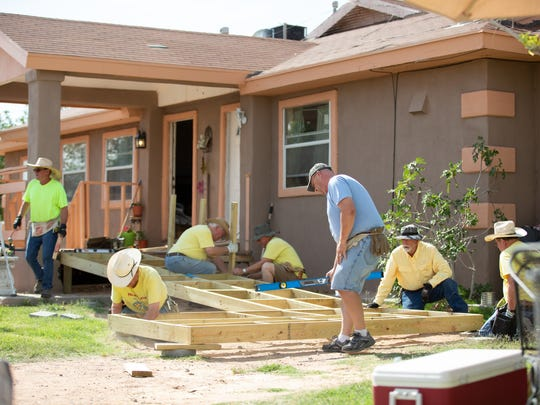 Members of the Ramp Rats, a group with the Las Cruces University Methodist Church, work to build a ramp at a home in Chaparral on Saturday, June 2, 2018.