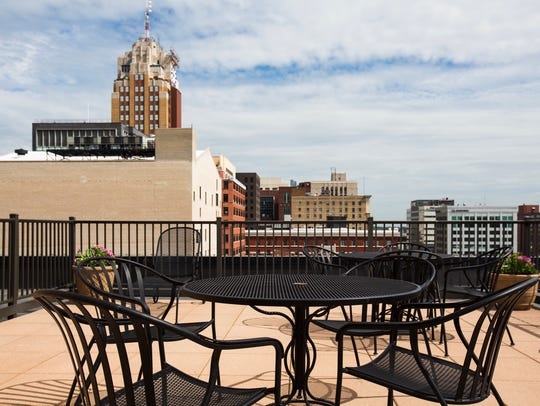 A communal patio gives a great view overlooking the city skyline.