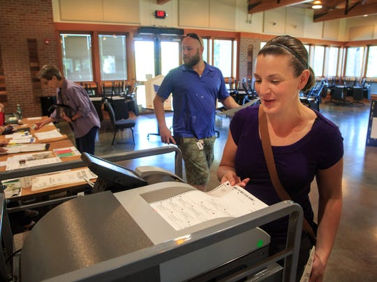 Stephanie Johnson casts her primary ballot at the Windsor