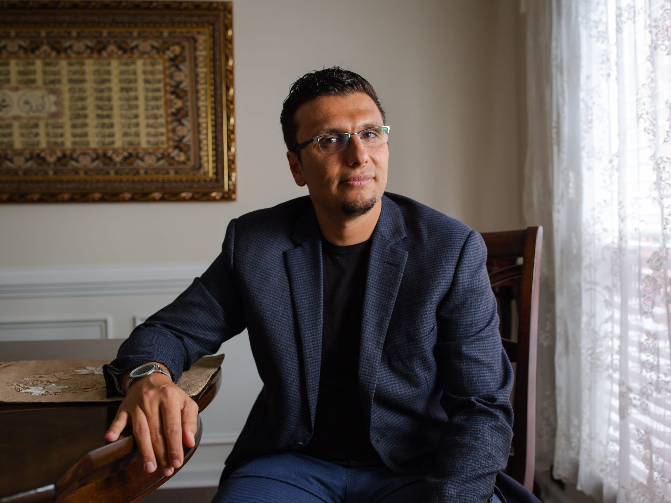Heval Kelli at his home in Atlanta. The cardiologist, a Syrian Kurd whose family was granted asylum in the United States in 2001, offers himself as an ambassador for Islam and for refugees.