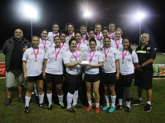 The Venue Slay with the championship trophy of the W2 Division of the Bud Light Women's Soccer League after the championship match Sunday at the Guam Football Association National Training Center. The Venue Slay defeated The Venue Sidekicks 1-0 to claim the 2018 Spring title.