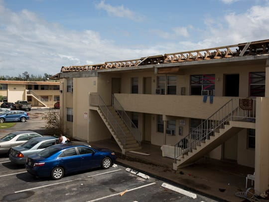 Several buildings in the Gordon River Apartment Complex had their roofs blown away by Hurricane Irma. Damage can be seen Monday, Sept. 11, 2017.