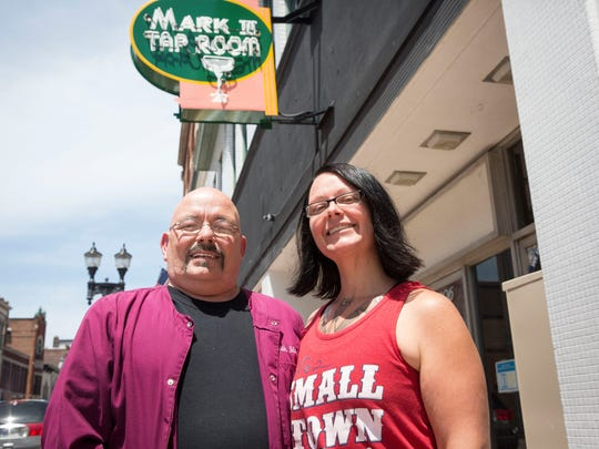 Keith Martz and Natasha Martz stand in front of their bar the Mark III Tap Room, in 2018 around the time of the bar's 50th anniversary celebration.