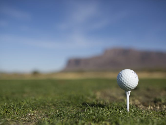 A golf ball sits on a tee at the Superstition Mountain