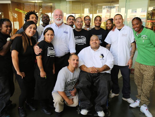 Father Gregory Boyle in the lobby of Homeboy Industries