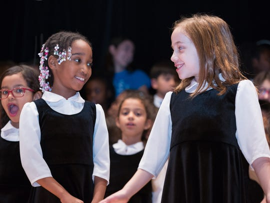 Children performing in the Music Discovery Partnership, a collaboration between the JCC Thurnauer School of Music and the Englewood School District.