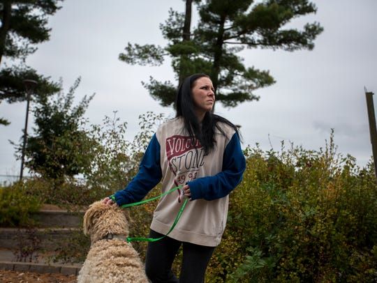 Sarah Bear walks with a therapy dog to calm her nerves