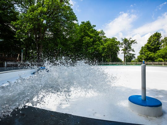 Workers fill Moores Park Pool with water. In total,