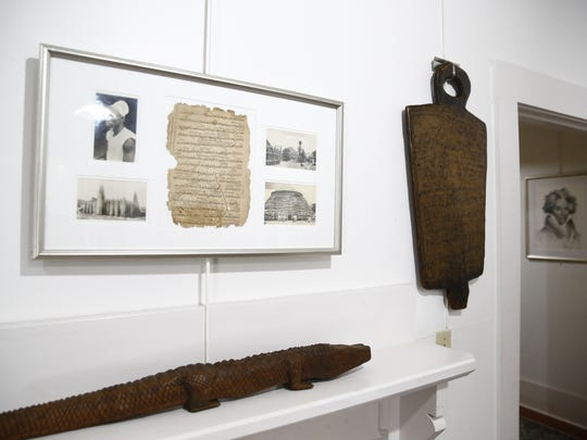 Hakim Willie Jones, a collector from Savannah, Georgia, displays a portion of his collection of historical slave artifacts from Western Africa and the American South at the Riley House Museum.